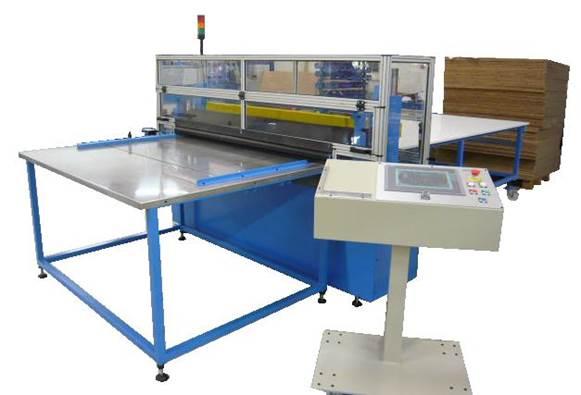 Guillotina automática con sistema de avance para corte de materiales flexibles